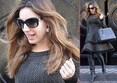 Kelly Brook  Looking as if she was already in a photoshoot, Kelly Brook ran errands in London, England on Thursday (February 7).    The British beauty wore a long-sleeved dark gray dress with thigh-high heeled leather boots and a matching handbag as she strutted her stuff on the streets.