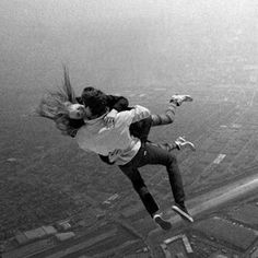 kissing while falling mid air - cool