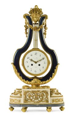 MAISON MILLET 1853 - 1918 A LOUIS XVI STYLE GILT BRONZE, BLUED STEEL AND WHITE MARBLE LYRE-SHAPED MANTEL CLOCK FRANCE, EARLY 20TH CENTURY the black and white enamel dial with roman numerals and indistinctly inscribed, stamped MILLET behind the female mask finial.