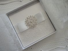 boxed invite with embossing & large brooch