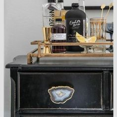 I can't even handle how in love with this idea i am! Take any old furniture, screw in an agate drawer handle & voila!