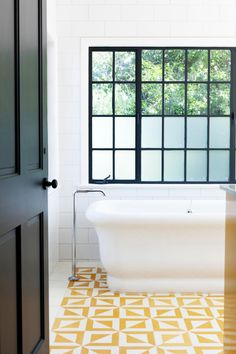 Tour a Bright, Fresh LA Family Home // freestanding modern bathtub, yellow geometric tiles, bathroom Floor tiles Bad Inspiration, Bathroom Inspiration, Interior Inspiration, Yellow Bathroom Decor, Yellow Bathrooms, Bathroom Black, Bathroom Closet, Yellow Tile, White Tiles