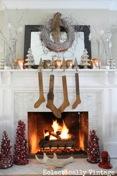 Winter White Mantel - branches, snowflakes and mercury glass #mantel #Christmas