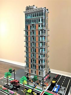 wooootles completed the 505 Wasabi apartment tower. The contemporary skyscraper has over 6000 pieces and many amenities such as a roof top swimming pool and Dunkin Donuts. Lego City, Minecraft City, Legos, Lego Skyscraper, Rammed Earth Homes, Lego Boards, Lego Design, Modular Design, Lego Modular