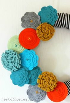A beautiful handmade decor, my Fashion Forward Fall Felt Flower Wreath combining flowers, stunning Fall colors with stripes! What's not to love?