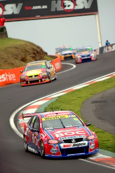 Jason Bright in his Team BOC Commodore coming down the Esses at Mount Panorama Circuit during the 2011 Official V8 Supercars Supercheap Auto Bathurst 1000.    Photo by Craig Coomans ©. Feel free to share, simple ensure you credit the photo to me.