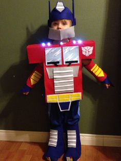 No-sew Optimus Prime costume   Felt, foam core, hot glue, finger lights