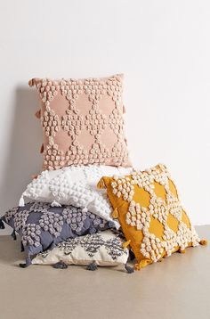 Embellished with tufted dots arranged in a geo pattern this throw pillow adds tonal texture  dimension to your space. Finished with tassel accents at edges. Content  Care    Cotton    Machine wash    Imported   Size    Dimensions 18l x 18w Urban Outfitters Apartment, Urban Outfitters Bedroom, Urban Outfitters Art, Couch Pillows, Floor Pillows, Throw Pillows, Decorative Bed Pillows, Accent Pillows, 3d Christmas