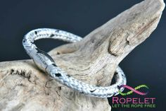 Beautiful silver and black Ropelet  that's just waiting to go on your wrist! One of the fab bracelets by www.ropelet.co.uk,  made to your order in the UK and shipped worldwide.  Leather and rope ranges and so much more await you. Click on www.ropelet.co.uk today. #ladiesbracelet #fashionbracelet #fashionaccessories #handmadegift #mensbracelet #mensfashion #menstyle #menswear #ropelet #ropebracelet #bracelet #leatherbracelet #climbingbracelet #skateboarding #snowboarding #surferbracelet