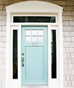 eclectic entry by Four Chairs Furniture Love the numbers on the door and the pale teal colour!