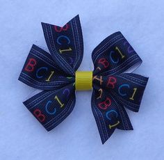 Back to School Hair Bow, Small  Boutique Hair Bow, Pinwheel Hair Bow, Small Hair Bow, School Hair Bow, Simple Boutique Bow, Basic Hair Bow by LizzyBugsBowtique on Etsy https://www.etsy.com/listing/238542914/back-to-school-hair-bow-small-boutique