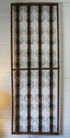 I want these 19th century bed springs from a hired man's bed to hang horizontally on a long wall.