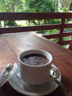 A perfect Balinese morning, Indonesian coffee and palm trees.
