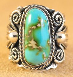 Handmade ring, with natural rare Royston Turquoise, by Navajo artist Andy Cadman.