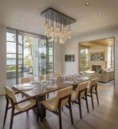 I like the dining chairs.  shingle-style-lakefront-house-stuart-silk-architects-05-1-kindesign