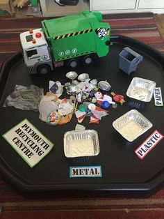 Create an intentional teaching experience with this set up, great for discussing recyclable items and processes.: