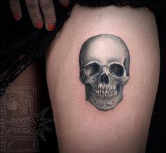 Opaque grey skull tattoo by Chris Rigoni