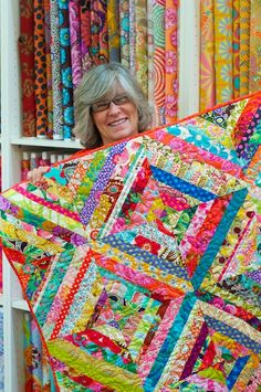 Valli & Kim: Valli's First Quilt!!!!  ~ so much color and pattern, yet it totally works. Plus, using selvages is so cool!!
