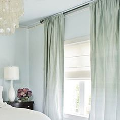 High Drapes - hang rod from ceiling to draw eye up and let in more light.  If curtains are not long enough, add a strip of fabric to customise