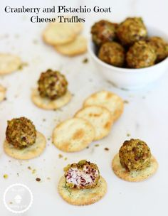 Mini cheese balls made with goat cheese, cranberries, pistachios, honey, and garlic! A perfect party appetizer!