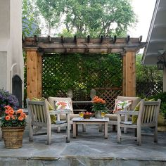 Functioning more as walkway than spot for repose, a pergola adds drama to a yard.  -- If a pergola backs up to a neighboring yard, enclose one side with trellis or another semi-transparent wall.  -- A pergola here bridges the space between the house and fireplace.