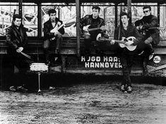 The Beatles in Hamburg. Pete Best (left) and Stuart Sutcliffe (right) were aboard, though the core of the band was from the beginning Lennon-McCartney-Harrison.