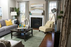 Neutral grey living room with pops of teal and yellow by designer Ash Morsi