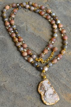 "Champagne druzy, faceted sandstone, gold hematite and crystal with gold trimmed druzy. Necklace is approximately 33"" in length. Customization available upon request."