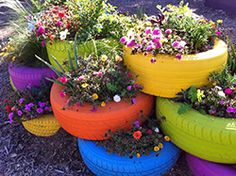 Although I would personally stick to more earthy tones on the tires, this truly is a brilliant way to keep a great and neat flower garden!