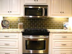 microwave is flush with cabinets depth and height wise adding to built-in appearance.