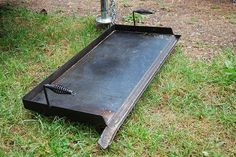 Homemade griddle 16X32X1/4 steel plate. Used 1/8X1 flat to form the back and side splash. And 11/2 angle on the front for a grease run off into a coffee can. Cut the heads off a couple spring handle chipping hammers bent the handle and welded them to the sides No seasoning is needed but you need to clean it like you would cast iron.