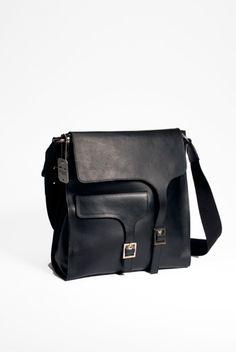 REPORTER BLACK Black unisex natural vegetable tanned leather messenger bag with shoulderstrap and silver hardware. Width 38cm, Hight 38cm