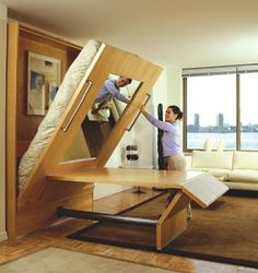 Dual Function Murphy Bed/Table for Tiny Homes.  Great idea for an office space that can be turned unto a guest space.