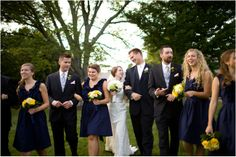 groomsmen in black suits with grey ties and yellow flowers