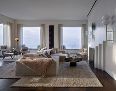 Kelly Behun has created a show residence near the top of Rafael Viñoly's 432 Park Avenue, using a palette that complements the sweeping Manhattan views.