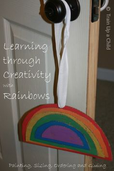 Sizing a Rainbow {Rainbow Craft for Preschoolers} Learn through play:  painting, ordering by size, fine motor skills, creativity and more!