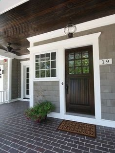 dark wood front door gray house white trim by isabelle07