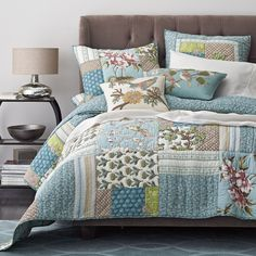 The Adeline patchwork quilt is an imaginative mix of birds and blooms, paisleys and stripes. All cast in weathered shades of blue, green, mauve and pink.