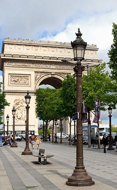 A notable landmark in Paris, the Arc de Triomphe stands at the west end of the Champs-Élysées, construction began August 15,1806 -Inaugurated July 29 1836 honors those who fought in French Revolution and Napoleonic wars. Beneath lies the Tomb of the Unknown Solider from World War I.