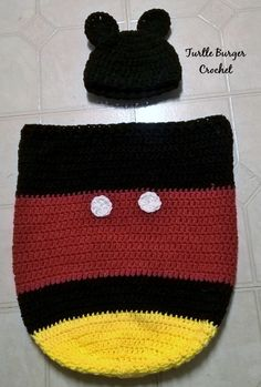 FREE PATTERN: Mickey Mouse Newborn Cocoon & Hat – Turtle Burger Crochet [gallery Here is my first official pattern. I'm really very excited. This is a set I made for a coworker expecting her first child. She absolutely loved it a… Crochet Baby Hats Free Pattern, Newborn Crochet Patterns, Crochet Bebe, Crochet For Boys, Baby Blanket Crochet, Baby Patterns, Free Crochet, Baby Afghans, Crochet Disney