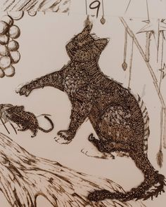 CLOSE UP: A cat is embroidered in black and silver beads, tiny sequins and glass stones as part of the magical map dress.