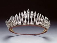 "Both, Queen Elizabeth II, & her daughter,  Princess Anne wore the ""fringe"" tiara, which resembles the spiky crown of the Statue of Liberty."