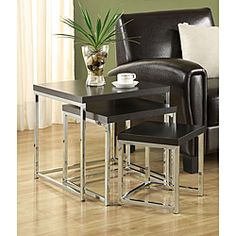 @Overstock - Beautiful and functional, the tables come in small, medium and large size that can be easily stacked on top of each other. These tables have a modern style chrome design frame that enhances your decor with its rich cappuccino finish table tops.http://www.overstock.com/Home-Garden/Cappuccino-Chrome-Finish-Nesting-Side-End-Tables-Set-of-3/6573274/product.html?CID=214117 $122.99