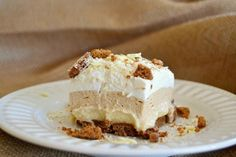 Biscoff Cookie Spread, White Chocolate Pudding and crushed Biscoff Cookies make these NO BAKE bars a dream!
