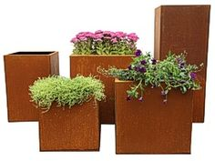Squares and Tall Squares made from CorTen steel with a rusty appearance. Plastic Planters, Metal Planters, Large Planters, Planter Pots, Famous Structures, Terraced Landscaping, Weathering Steel, Angel Of The North, Gravel Garden