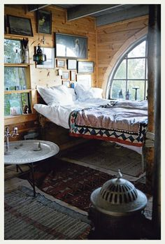 via An Indian Summer. I love the high bed against the window.