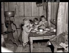 Depression: 1936 Christmas dinner of potatos, cabbage and pie. It would be a pity if this happened again.