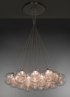 Kadur 19 Cluster Chandelier; Artisan made, blown glass custom designed lighting. Drizzled glass threads hover suspended in midair caught within pristine glass orbs. Available at www.BahirLighting.com