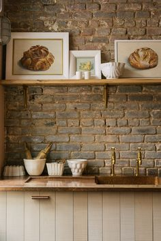 A close up of the sink run in our Sebastian Cox Kitchen in the New York showroom. If you click the link you can have a read all about this kitchen renovation and see all the gorgeous shots we have. This space is so beautiful, it's tactile and rustic while still keeping a little hint of glam. #deVOLKitchens #RusticInteriors #ExposedBrick #OpenShelving Devol Kitchens, Grey Kitchens, Home Kitchens, Rustic Kitchen Design, Home Decor Kitchen, Kitchen Ideas, Classic Shelves, Manhattan, Fruit And Vegetable Storage