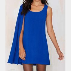 "Nasty Gal ""Flygirl"" Cape Dress New with tag Nasty Gal cape dress! Completely sold out! One shoulder cape, perfect for a prom after party! Nasty Gal Dresses Mini"